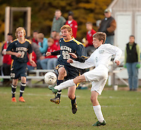 Bow's Ryan Hill and Hopkinton's Henry Merrow battle for the soccer ball during NHIAA Division III boys varsity soccer matchup Monday afternoon.  (Karen Bobotas/for the Concord Monitor)