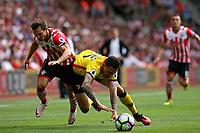 Football - 2016 / 2017 Premier League - Southampton vs. Watford<br /> Southampton's Cedric Soares bundles Jose Holebas of Watford off the ball at St Mary's Stadium Southampton <br /> <br /> Colorsport/Shaun Boggust