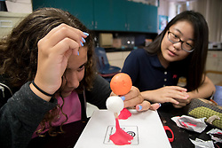 August 21, 2017 - Boynton Beach, Florida, U.S. - (l tor) Avraelle Brodsky and Karis Hong work on a clay model of the solar eclipse during an accelerated science class at Christa McAuliffe Middle School in Boynton Beach, Florida on August 21, 2017. (Credit Image: © Allen Eyestone/The Palm Beach Post via ZUMA Wire)