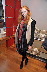 LILY COLE at a party in aid of the charity Best Buddies held at the Hogan store, 10 Sloane Street, London SW10 on 13th May 2009.