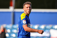 AFC Wimbledon defender Luke O'Neill (2) walking on pitch with mouth open about to speak during the EFL Sky Bet League 1 match between AFC Wimbledon and Plymouth Argyle at the Kiyan Prince Foundation Stadium, London, England on 19 September 2020.