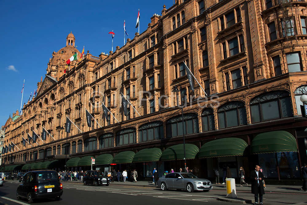 Harrods department store in the exclusive area of Knightsbridge. In a selected few boroughs of West London, wealth has changed over the last couple of decades. Traditionally wealthy parts of town, have developed into new affluent playgrounds of the super rich. With influxes of foreign money in particular from the Middle-East. The UK capital is home to more multimillionaires than any other city in the world according to recent figures. Boasting a staggering 4,224 'ultra-high net worth' residents - people with a net worth of more than $30million, or £19.2million.. London, England, UK.