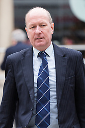 © Licensed to London News Pictures. 23/04/2015. London, UK. Returning Officer, John Williams arrives at the Royal Courts of Justice, High Court in London for the ruling of the Tower Hamlets election petition trial. The election petition, brought by four residents, which is led by Andrew Erlam against Lutfur Rahman seeks a re-run of last May's mayoral election in the east London borough of Tower Hamlets.. Photo credit : Vickie Flores/LNP