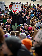 """15 MARCH 2019 - ST. PAUL, MINNESOTA, USA: A student stands in the middle of the crowd during the MN Youth for Climate Justice """"Climate Strike"""" at the Minnesota State Capitol in St. Paul, MN. Thousands of high school students braved below freezing temperatures and biting winds to demand action on climate change. The Minnesota Climate Strike was inspired by the strike by Greta Thunberg, a Swedish high school student, who started a climate strike at her school in August 2018.       PHOTO BY JACK KURTZ"""