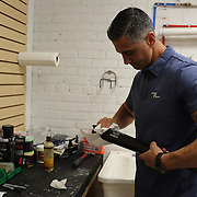 Pete Tucci puts the finishing touches to the engraving on a Troy Tulowitzki  baseball bat in his factory, Tucci Lumber Company, which makes baseball bats. Norwalk, Connecticut, USA. 27th June 2014. Photo Tim Clayton