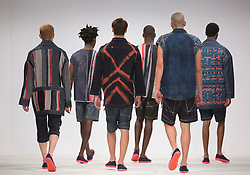 © Licensed to London News Pictures. 01/06/2015. London, UK. Collection by Kenneth Susaya. Fashion show of Bath Spa University at Graduate Fashion Week 2015. Graduate Fashion Week takes place from 30 May to 2 June 2015 at the Old Truman Brewery, Brick Lane. Photo credit : Bettina Strenske/LNP