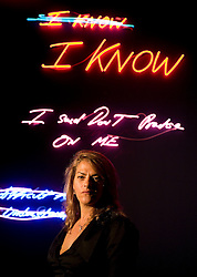 """© licensed to London News Pictures. London, UK. 16/05/2011. Tracey Emin poses underneath her artwork at a photo call for the preview of Tracey Emin's new exhibition """"Love is What You Want"""" at Hayward Gallery, Southbank, London today (16/05/2011).  Photo credit should read Ben Cawthra..."""