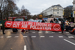 PICTURED: A banner demands a cut to air pollution in London. Demonstrators from the anti-pollution group Stop Killing Londoners cause traffic chaos for London commuters as they conduct a series of short roadblocks at Marble Arch stopping cars and buses from entering Oxford Street and Park Lane. Irate motorists accused them of creating more pollution than they were stopping, whilst the group said their objectives were long term. A leaflet handed out to motorists says the government is not doing enough to tackle the crisis costing 'taxpayers and the NHS £billions [sic] a year'. PLACE, January 29 2018. © Paul Davey