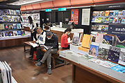Readers browse magazines at a branch of a bookstore chain that is open 24 hours.