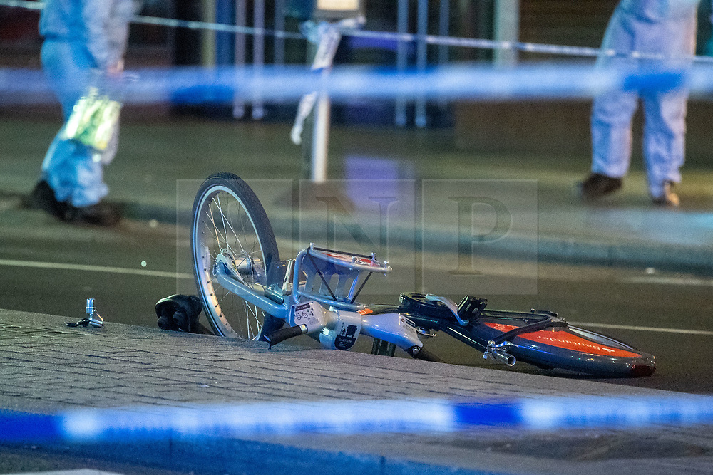 © Licensed to London News Pictures. 22/07/2021. London, UK. A damaged bicycle at the scene following a fatal stabbing on Brixton Road, Brixton. Metropolitan Police Service (MPS) were called at 20:18BST on Wednesday 21 July to reports of an assault close to Brixton Underground Station. Despite efforts from police officers, paramedics from London Ambulance Service (LAS) and London's Air Ambulance the man was pronounced dead at the scene at the 20:45BST. Photo credit: Peter Manning/LNP