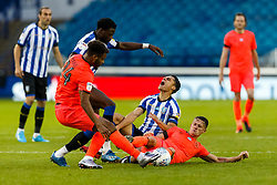 Joey Pelupessy of Sheffield Wednesday is fouled by Jonathan Hogg of Huddersfield Town - Mandatory by-line: Daniel Chesterton/JMP - 24/06/2020 - FOOTBALL - Hillsborough - Sheffield, England - Sheffield Wednesday v Huddersfield Town - Sky Bet Championship
