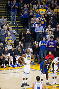 Fans celebrate Golden State Warriors forward Kevin Durant's (35) 20,000 career point at Oracle Arena in Oakland, Calif., on January 10, 2018. (Stan Olszewski/Special to S.F. Examiner)