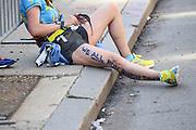 April 21, 2014 - Boston, Massachusetts, U.S. - <br /> <br /> Boston Marathon 2014<br /> <br /> Tens of thousands of runners cross the finish line of the 2014 Boston Marathon in Boston, Massachusetts. Two runners embrace after finishing the race. <br /> ©Exclusivepix