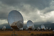 Storm clouds over Radio Telescope receiving dishes at the UC Radio Astronomy Observatory, Hat Creek, Shasta County, California