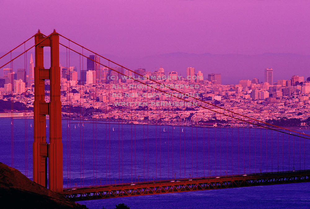 Image of Golden Gate Bridge in San Francisco, California with skyline and sailboats in bay by Andrea Wells