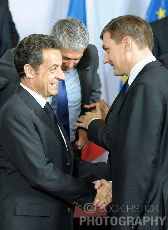 Nicolas Sarkozy, France's president, left, speaks with Andrus Ansip, Estonia's prime minister, during the European Summit, Thursday, March 19, 2009, in Brussels, Belgium. (Photo © Jock Fistick)