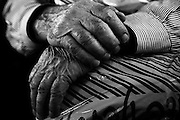 Close up of hands of an old man in black and white