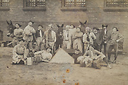 group of farmer workers posing for a photograph