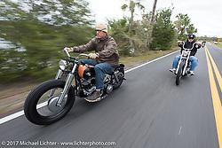 Eric Stein on his 1964 Harley-Davidson Panhead riding through Tomoka State Park just ahead of Chris Wade during Daytona Beach Bike Week. FL. USA. Tuesday, March 14, 2017. Photography ©2017 Michael Lichter.