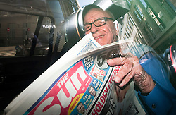 © Licensed to London News Pictures. 26/02/2012. London, UK. RUPERT MURDOCH, Chairman and CEO of News Corporation reading a copy of The Sun on Sunday as he leaves his home in central London on February 26th, 2012. The Sun on Sunday was launched today (26th/02/2012) after News International closed its Sunday paper, the News of the World, last year amid the scandal over phone hacking. Photo credit : Ben Cawthra/LNP