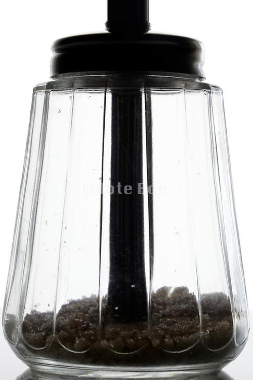 near empty sugar glass jar tradition old style measured dispenser