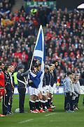 15.02.2015. Edinburgh. RBS 6 Nations 2015 Scotland v Wales.  The Scottish squad and mascots during Flower Of Scotland the national anthem. from Murrayfield Stadium, Edinburgh.