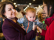 08 NOVEMBER 2019 - DES MOINES, IOWA: US Senator AMY KLOBUCHAR (D-MN), holds a baby during a campaign event in Ankeny, a suburb of Des Moines. Sen. Klobuchar is campaigning to be the Democratic nominee for the US Presidency. Iowa holds the first selection event of the Presidential election cycle. The Iowa caucuses are Feb. 3, 2020.          PHOTO BY JACK KURTZ