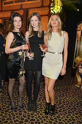 Left to right, KATIE BALL, GEORGINA BEVAN and ELINOR WEEDON at the Warner Music Brit Party held at the Freemason's Hall, 60 Great Queen Street, London on 25th February 2015.