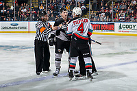 KELOWNA, BC - JANUARY 4: Referee Chris Crich and line official Dustin Minty attempt to restore order as Justin Lies #36 of the Vancouver Giants gets in the face of Devin Steffler #4 of the Kelowna Rockets during second period at Prospera Place on January 4, 2020 in Kelowna, Canada. (Photo by Marissa Baecker/Shoot the Breeze)