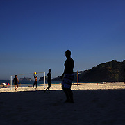 Locals play beach football during the late afternoon sunshine at Sao Conrado beach, Rio de Janeiro,  Brazil. 8th July 2010. Photo Tim Clayton...