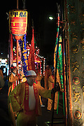 Marchers line up during a temple parade to honor the Qingshan Wang deity in Taipei.