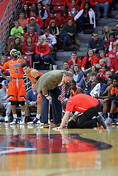 10 December 2016:  Dan Muller, Head Coach and John Munn attend to Keyshawn Evans(3) after Evans makes a hard trip to the wood during an NCAA  mens basketball game between the UT Martin Skyhawks and the Illinois State Redbirds in a non-conference game at Redbird Arena, Normal IL