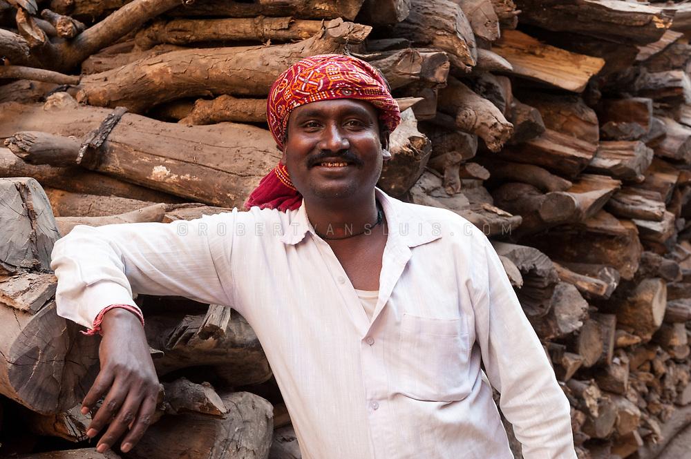 Portrait of a firewood seller near Manikarnika cremation ground, Varanasi, India. Photo © robertvansluis.com