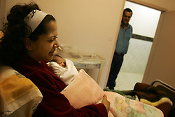 Mary Kheir, is held by her mother for the first time at Al-Dibs Maternity Hospital in Bethlehem, Palestinian Territories, Nov. 14, 2004. The baby, born into a Christian family, is the first for the Kheir family.