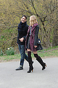 A fashion shoot in Central Park, Manhattan. The model's left shoe has nearly lost its heel, but the show must go on.<br />