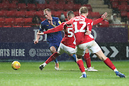 AFC Wimbledon midfielder Mitchell (Mitch) Pinnock (11) dribbling and prior to red card, sent off during the EFL Sky Bet League 1 match between Charlton Athletic and AFC Wimbledon at The Valley, London, England on 15 December 2018.