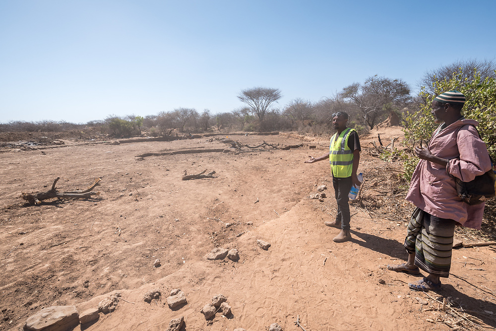 28 January 2019, Wada IDP site, near Micha kebele, Seweyna woreda, Bale Zone, Oromia, Ethiopia: LWF Project manager Dereje Teka oversees the construction of a 10,000-cubic-meter ponds in the area. Once filled up by seasonal rains, ponds like this one near the Wada IDP site, will provide a last resort for water through the driest months of the year. The Lutheran World Federation supports internally displaced people in several regions of Ethiopia, through emergency response on water, sanitation and hygiene (WASH) as well as long-term development and empowerment projects, to help build resilience and adapt communities' lifestyles to a changing climate.