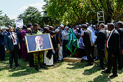 JOHANNESBURG, March 29, 2017  Helpers put the body of Ahmed Kathrada into the grave during his funeral at Westpark Cemetery in Johannesburg, South Africa, on March 29, 2017. South African anti-apartheid stalwart Ahmed Kathrada died in the early hours of Tuesday morning at the age of 87.  sxk) (Credit Image: © Zhai Jianlan/Xinhua via ZUMA Wire)