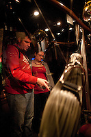 """Guests look at Quidditch equiptment at the """"Harry Potter"""" exhibition at Discovery Times in New York. ..Photo by Robert Caplin."""