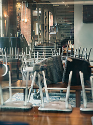 © Licensed to London News Pictures. 20/03/2018. Salisbury, UK. Chairs remain placed on the tables inside The Mill pub as police continue their investigation after former Russian spy Sergei Skripal and his daughter Yulia were poisoned with nerve agent. The couple where found unconscious on bench in Salisbury shopping centre. A policeman who went to their aid is currently recovering in hospital. Photo credit: Peter Macdiarmid/LNP