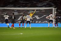 Football - 2020 / 2021 EFL Carabao League Cup - Semi-Final - Tottenham Hotspur vs Brentford - Tottenham Hotspur Stadium<br /> <br /> Moussa Sissoko of Spurs scores his first half goal past goalkeeper, David Raya<br /> <br /> COLORSPORT/ANDREW COWIE