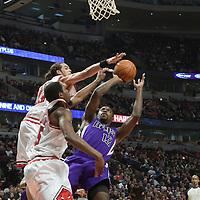 21 December 2009: Chicago Bulls center Joakim Noah blocks the shot from Sacramento Kings guard Tyreke Evans during the Sacramento Kings 102-98 victory over the Chicago Bulls at the United Center, in Chicago, Illinois, USA.