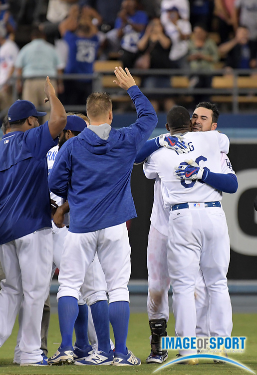 Sep 19, 2016; Los Angeles, CA, USA; Los Angeles Dodgers first baseman Adrian Gonzalez (23) celebrates with right fielder Yasiel Puig (66) after hitting a walk-off double in the ninth inning in a 2-1 victory over the San Francisco Giants during a MLB game at Dodger Stadium.
