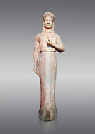 Parian marble Ancient Greek Archaic statue of a kore by Ariston of Paros, found in Merenda, Attica, Circa 540-530 BC, Athens National Archaeological Museum. Cat no 4889. Against grey.<br /> <br /> This funerary statue was found in the same pit as Phrasikleia cat no 4890. The expression on the face and the rendering of the garment that follows the curves of the body underneath are remarkable. The chiton retains in many places its painted decoration with rosettes, swastikas, stars and meanders. This Kore is an extraordinary statue and is one of the most inportant of the Archaic Period. Mad by sculptor Ariston from Paros .<br /> <br /> If you prefer to buy from our ALAMY STOCK LIBRARY page at https://www.alamy.com/portfolio/paul-williams-funkystock/greco-roman-sculptures.html . Type -    Athens    - into LOWER SEARCH WITHIN GALLERY box - Refine search by adding a subject, place, background colour, etc.<br /> <br /> Visit our ROMAN WORLD PHOTO COLLECTIONS for more photos to download or buy as wall art prints https://funkystock.photoshelter.com/gallery-collection/The-Romans-Art-Artefacts-Antiquities-Historic-Sites-Pictures-Images/C0000r2uLJJo9_s0
