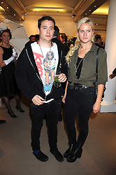 ADAM WAYMOUTH and OLYMPIA SCARRY at the annual Sotheby's Summer Party held at their auction rooms 34-35 New Bond Street, London W1 on 19th June 2008.<br /><br />NON EXCLUSIVE - WORLD RIGHTS