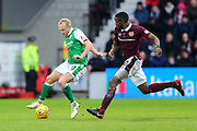 Dylan McGeouch (#10) of Hibernian controls the ball as Arnaud Djoum (#10) of Heart of Midlothian closes him down during the William Hill Scottish Cup 4th round match between Heart of Midlothian and Hibernian at Tynecastle Stadium, Gorgie, Scotland on 21 January 2018. Photo by Craig Doyle.