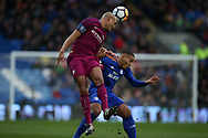 Vincent Kompany of Manchester city jumps above Kenneth Zohore of Cardiff city to head the ball. The Emirates FA Cup, 4th round match, Cardiff city v Manchester City at the Cardiff City Stadium in Cardiff, South Wales on Sunday 28th January 2018.<br /> pic by Andrew Orchard, Andrew Orchard sports photography.