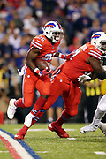 Buffalo Bills running back LeSean McCoy (25) jumps over the feet of of a lead block by Buffalo Bills tackle Cyrus Kouandjio (71) as he runs the ball for a short gain in the second quarter during the 2016 NFL week 2 regular season football game against the against the New York Jets on Thursday, Sept. 15, 2016 in Orchard Park, N.Y. The Jets won the game 37-31. (©Paul Anthony Spinelli)
