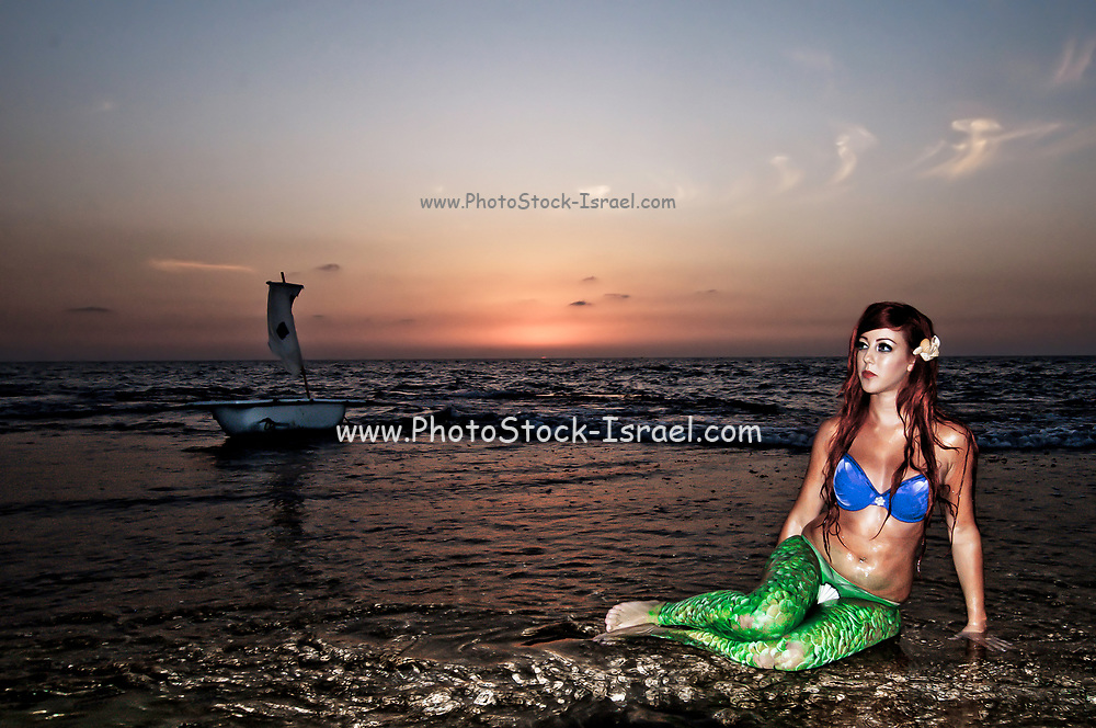 Mermaid on the beach at night