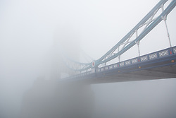 © Licensed to London News Pictures. 13/03/2014. London, UK. Thick fog shrouds Tower Bridge in London this morning, 13th March 2014. Photo credit : Vickie Flores/LNP